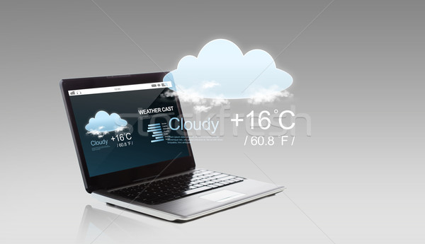 laptop computer with weather cast on screen Stock photo © dolgachov