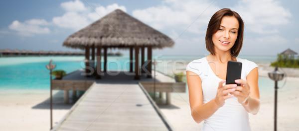 Feliz mulher praia viajar Foto stock © dolgachov