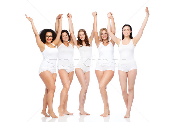Stock photo: group of happy different women celebrating victory