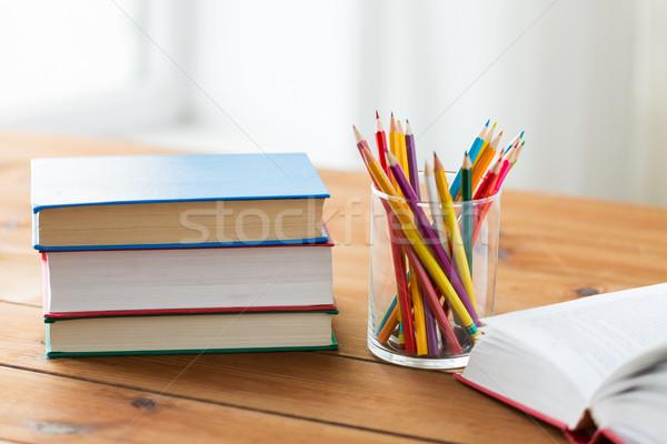 Kredki kolor ołówki książek edukacji Zdjęcia stock © dolgachov