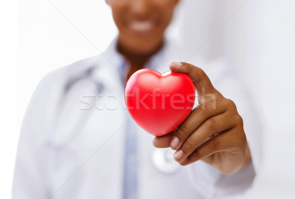 Stock photo: african female doctor with red heart