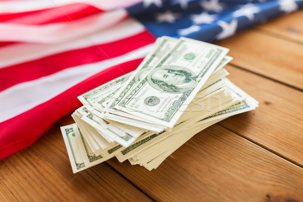 close up of american flag and dollar cash money Stock photo © dolgachov