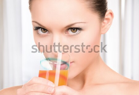 close up of woman drinking champagne at party Stock photo © dolgachov