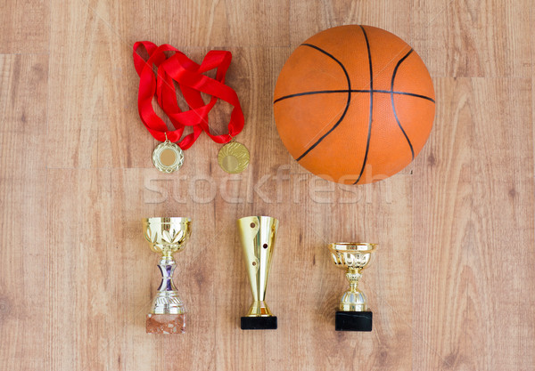 basketball ball with cups and golden medals Stock photo © dolgachov
