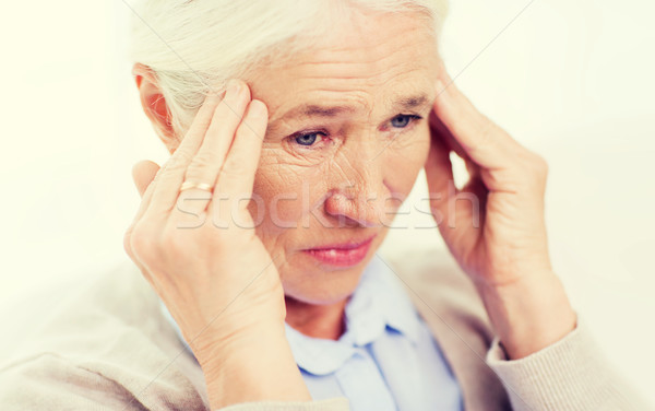 face of senior woman suffering from headache Stock photo © dolgachov