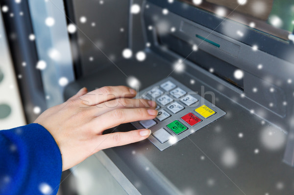 close up of hand entering pin code at cash machine Stock photo © dolgachov