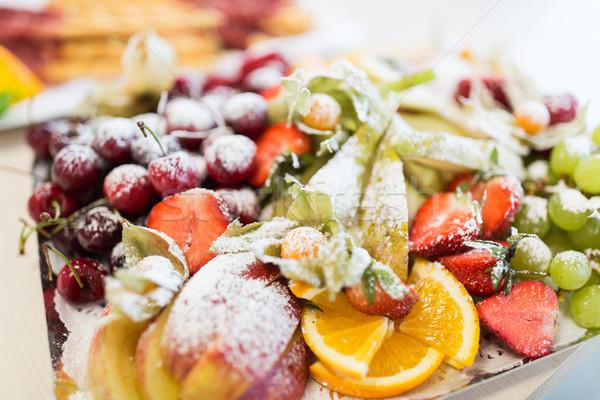 close up of dish with sugared fruit dessert Stock photo © dolgachov