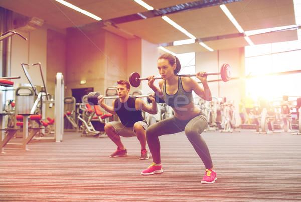 若い男 女性 訓練 バーベル ジム スポーツ ストックフォト © dolgachov