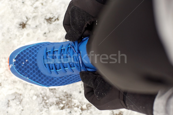 close up of man tying shoe lace in winter outdoors Stock photo © dolgachov