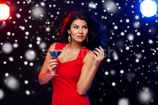 beautiful sexy woman with cocktail at nightclub Stock photo © dolgachov