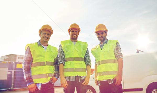 Feliz masculino construtores alto visível ao ar livre Foto stock © dolgachov