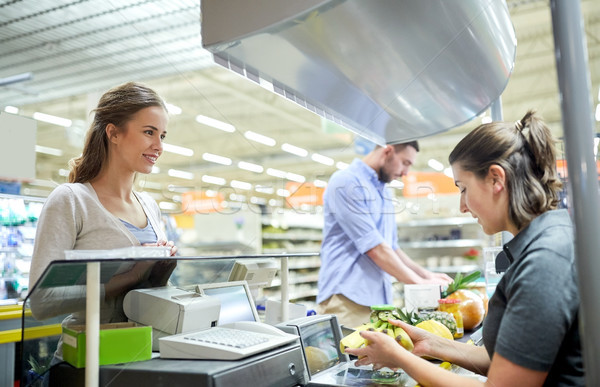 couple buying food at grocery store cash register Stock photo © dolgachov