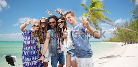 happy young women with white board on summer beach Stock photo © dolgachov