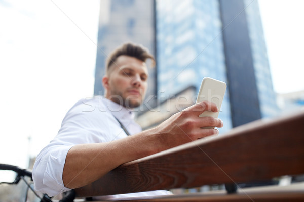 close up of man texting on smartphone in city Stock photo © dolgachov
