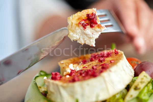 close up of woman eating goat cheese salad Stock photo © dolgachov