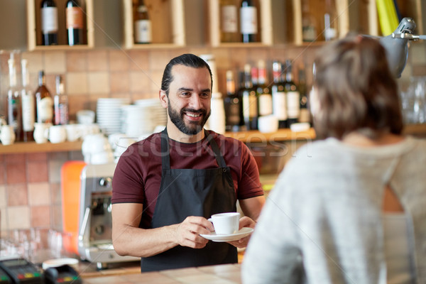 man or waiter serving customer in coffee shop Stock photo © dolgachov