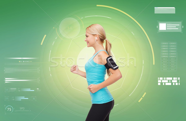 женщину смартфон спортивных фитнес спорт Сток-фото © dolgachov