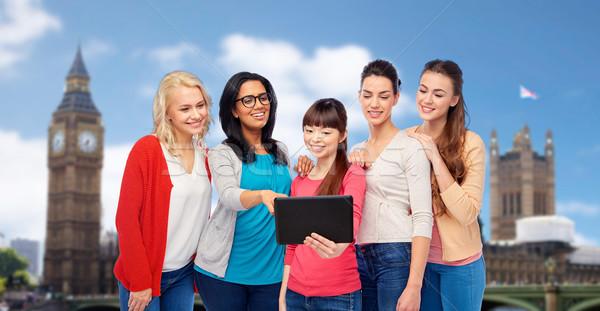 international group of happy women with tablet pc Stock photo © dolgachov