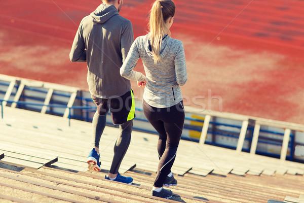 couple running downstairs on stadium Stock photo © dolgachov