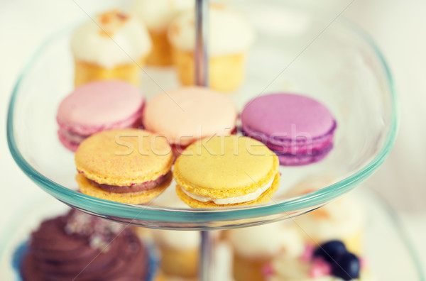 close up of cake stand with macaroon cookies Stock photo © dolgachov