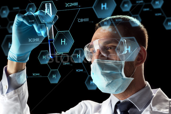 scientist with test tube and chemical formula Stock photo © dolgachov