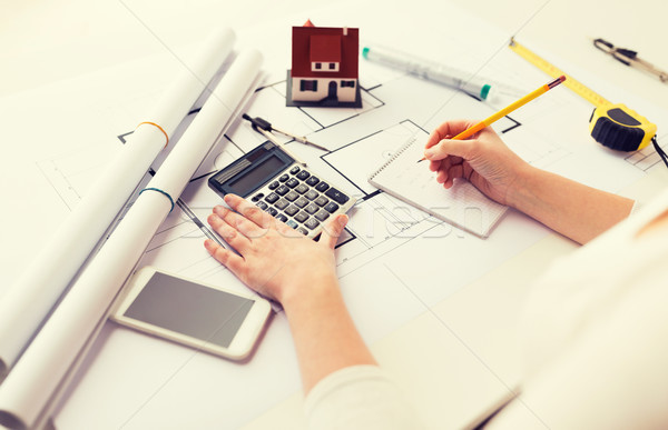 close up of architect hand counting on calculator Stock photo © dolgachov