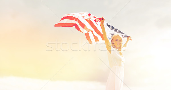 happy woman with american flag outdoors Stock photo © dolgachov
