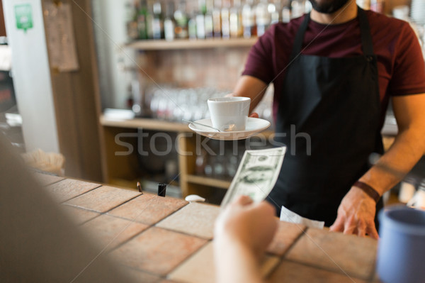 man or bartender serving customer at coffee shop Stock photo © dolgachov