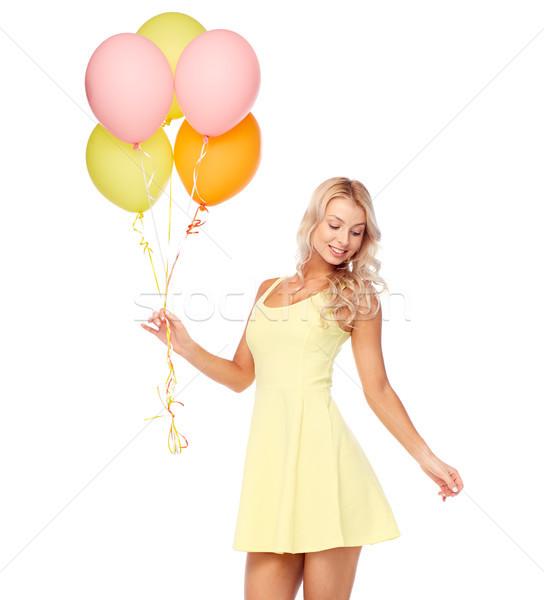 Boldog nő ruha hélium levegő léggömbök Stock fotó © dolgachov