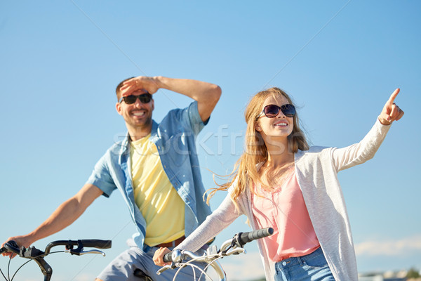 happy young couple with bicycles outdoors Stock photo © dolgachov