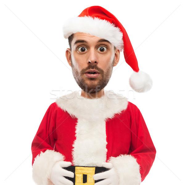 surprised man in santa claus costume over white Stock photo © dolgachov