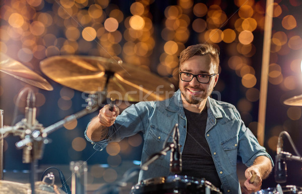 musician or drummer playing drum kit at concert Stock photo © dolgachov