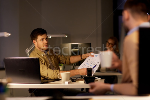 coworkers with papers working late at office Stock photo © dolgachov