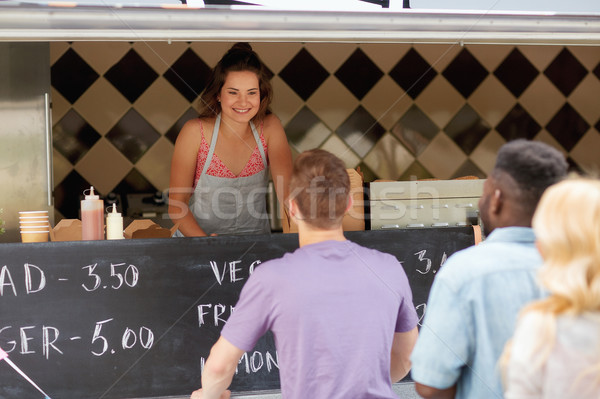 queue of customers and saleswoman at food truck Stock photo © dolgachov