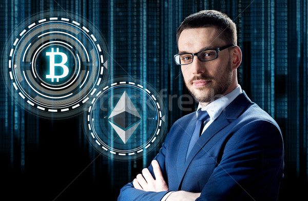 businessman with cryptocurrency holograms Stock photo © dolgachov