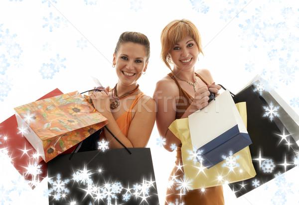 Shopping ragazze fiocchi di neve due felice Foto d'archivio © dolgachov