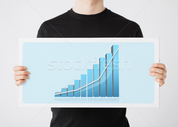 woman holding board with 3d graph Stock photo © dolgachov