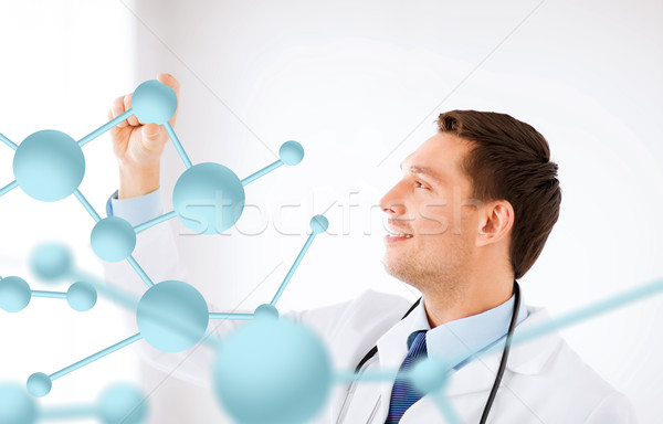 young doctor with molecules Stock photo © dolgachov