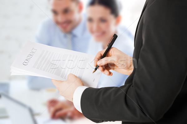 man signing contract Stock photo © dolgachov