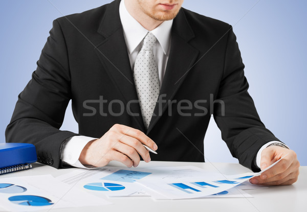 businessman working and signing with papers Stock photo © dolgachov