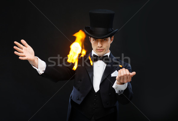 magician in top hat showing trick with fire Stock photo © dolgachov