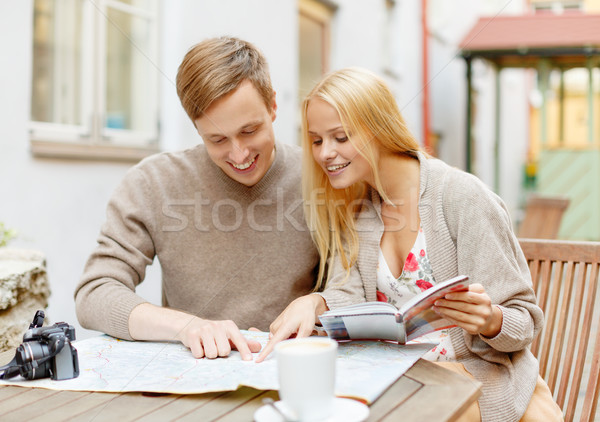 couple with map, camera, city guide and coffee Stock photo © dolgachov