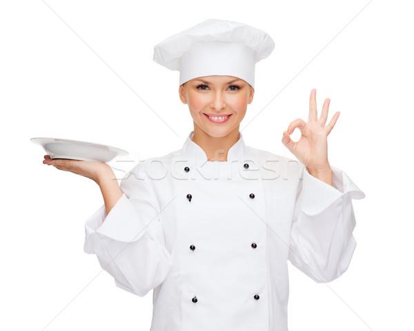 Stockfoto: Vrouwelijke · chef · lege · plaat · tonen
