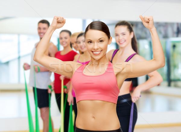 Personal trainer grup spor salonu uygunluk spor eğitim Stok fotoğraf © dolgachov