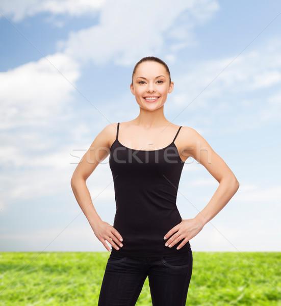 woman in blank black shirt Stock photo © dolgachov