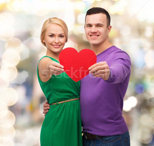 Uśmiechnięty para duży czerwony serca Zdjęcia stock © dolgachov