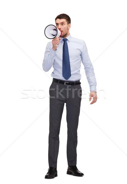 angry businessman with megaphone Stock photo © dolgachov