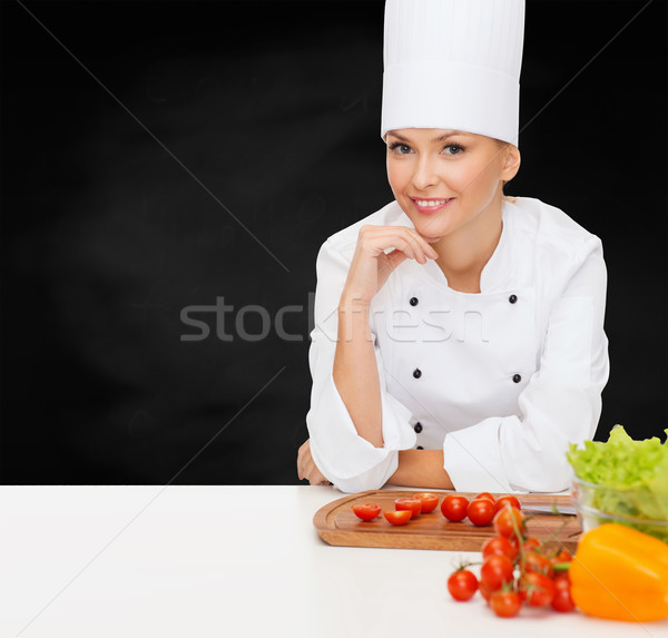 Stock photo: smiling female chef with vegetables