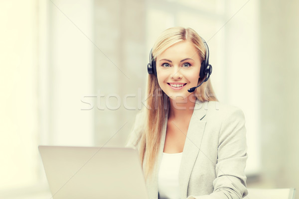 Stock photo: friendly female helpline operator with laptop