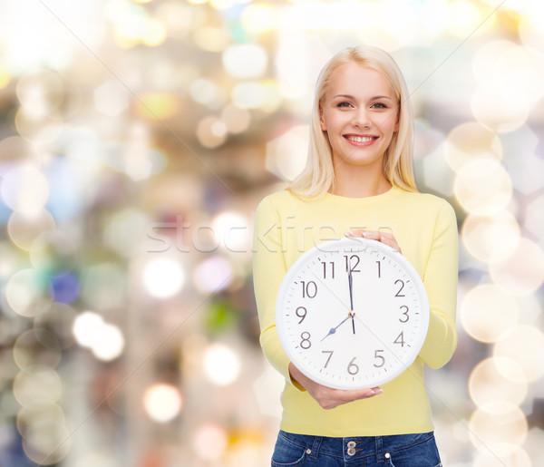 student with wall clock Stock photo © dolgachov